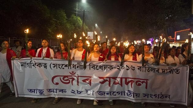 Activists of All Assam Students Union and various ethnic groups participate in a torch light procession to protest against Citizenship (Amendment) Bill 2016 in Gauhati on November 16.(AP File photo)