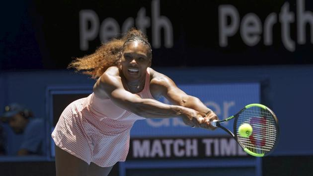 Serena Williams returns the ball during her match against Katie Boulter in the Hopman Cup in Perth.(AP)