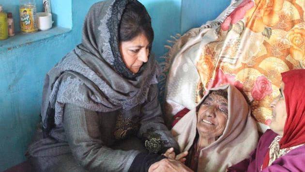 Former Jammu and Kashmir chief minister Mehbooba Mufti visits the family of a slain militant in Shopian district of Jammu and Kashmir on Thursday.(HT PHOTO)
