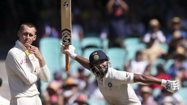 India's Rishabh Pant, right, celebrates making 100 runs as Australia's Marnus Labuschagne turns away on day 2 during their cricket test match in Sydney, Friday, Jan. 4, 2019(AP)