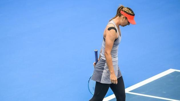 Maria Sharapova of Russia reacts during her women's singles quarter-final match against Aryna Sabalenka of Belarus at the Shenzhen Open tennis tournament.(AFP)