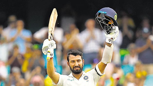 Cheteshwar Pujara celebrates his century on the first day of the fourth Test against Australia. When Rahul Dravid retired, Pujara was considered the perfect replacement. But the comparison has not always worked for the younger player.(AFP)