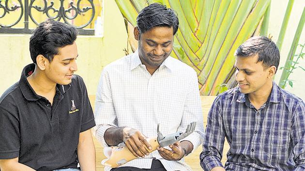 From Left: Advait, Pratik and Vishal who have developed a prosthetic hand in Pune.(Shankar Narayan/HT PHOTO)