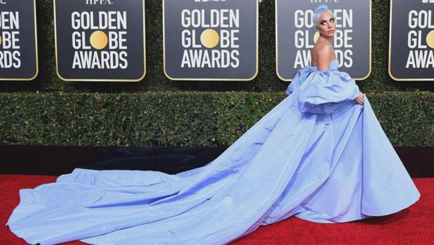 Golden Globes 2019 red carpet: Lady Gaga's Valentino dress seemed to pay homage to one worn by Judy Garland in the 1954 version of A Star is Born. She accessorized with a breathtaking Tiffany's diamond necklace. (AFP)
