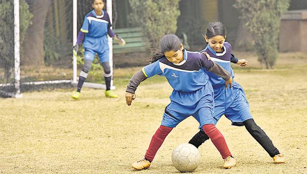School girls in action during a football practice session, at N.P Bengali Girls Senior Secondary School, in New Delhi, on Friday, January 4, 2019.(Vipin KUmar/HT Photo)
