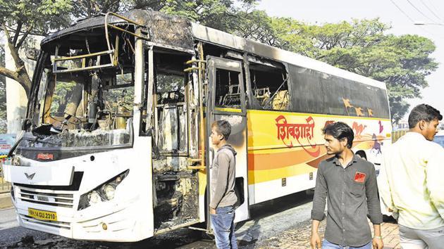 A MSRTC bus caught fire on the road leading to Golden Timber Mart in Kundannagar, near Kasarwadi on Pune-Mumbai road, on Sunday.(HT PHOTO)