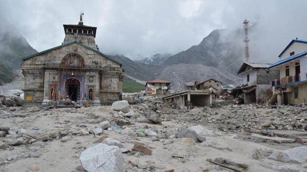 The 2013 floods washed away 16 km trek from the Kedarnath shrine to Gaurikund. It affected 9 million people in five districts, mostly in Rudraprayag where Kedarnath is situated.(HT File Photo)