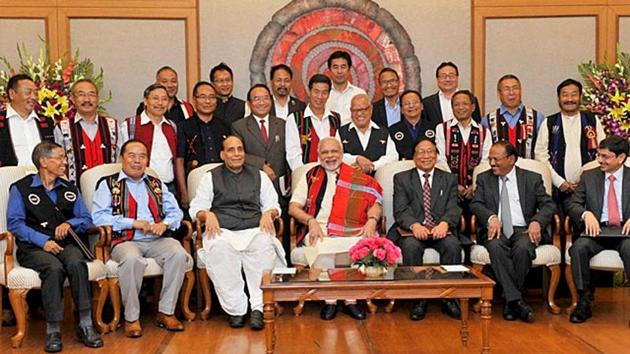 Prime Minister Narendra Modi with Union home minister Rajnath Singh, Chairman of NSCN (IM) Isak Chishi Swu, NSCN (IM) General Secretary Thuingaleng Muivah NSA, Ajit Doval and others at the signing ceremony of historic peace accord between Government of India & NSCN, in New Delhi on August 3, 2015.((PTI File Photo))