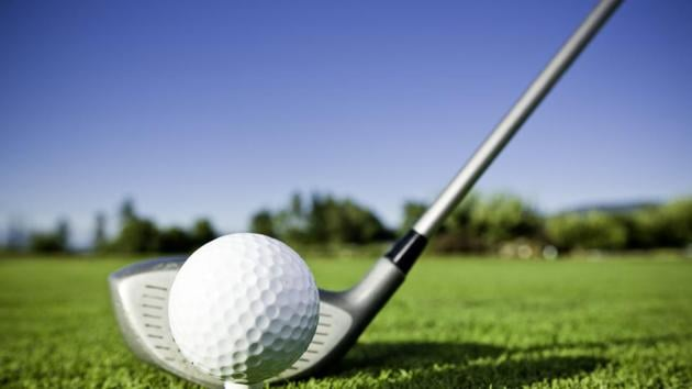 """""""A clean and simple shot of a golf ball and golf club. The bright, colorful backdrop has room for text.Our images are processed from""""(Getty Images)"""