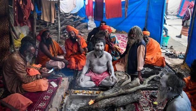 Sadhus of Juna Akhara sit inside their tent at Kumbh mela in Allahabad.(AFP)