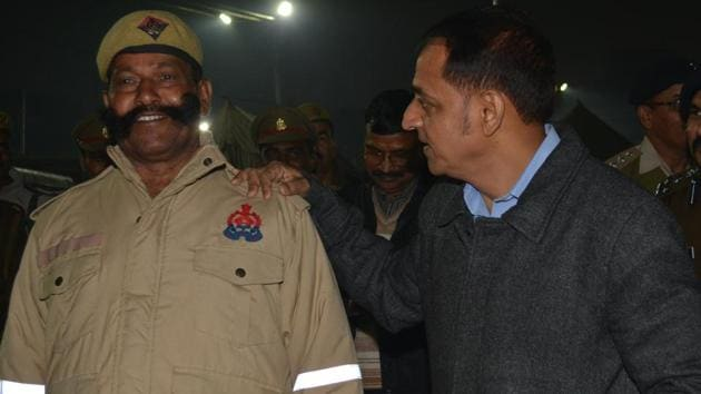 ADG PAC Binod Kumar Singh sharing a light moment with a PAC personnel sporting a big, twirly moustache during his recent visit to Kumbh Mela in Prayagraj(Sourced)