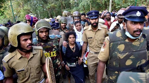 Bindu Ammini, 42, and Kanaka Durga, 44, are escorted by police after they attempted to enter the Sabarimala temple, Kerala, December 24, 2018(REUTERS)