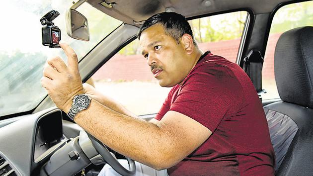 Saxena bought a Go Pro camera which can be set up on the windscreen of the car. Even through potholes, it does not give you a shaky image, he said.(HT PHOTO)