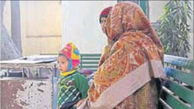 The woman's family members wait to receive the body inside the mortuary on Friday.(HT Photo)