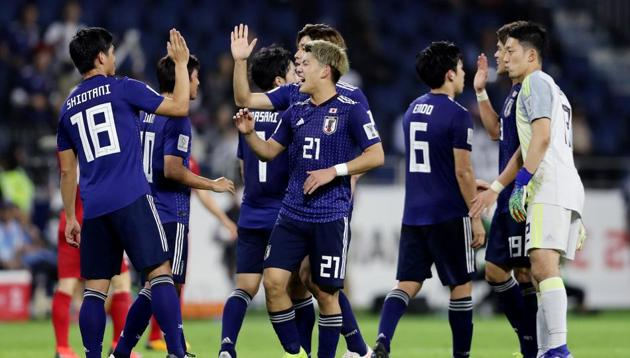 Japan's Ritsu Doan and team mates celebrate at the end of the match(REUTERS)