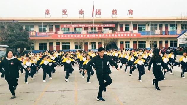 Zhang Pengfei is the principal of Xiguan Primary School in Linyi County in north China's Shanxi Province.(Screengrab)