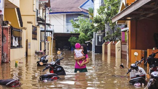 At least 68 people have been killed and thousands were forced to flee their homes after floods and landslides hit the island of Sulawesi, Indonesia.(AP)
