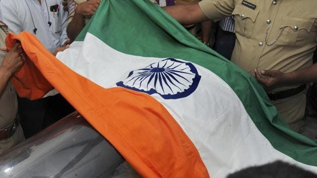 India is likely to lodge a protest on Monday against lack of security measures to prevent the burning of its national flag outside the Indian high commission on Republic Day.(AP)