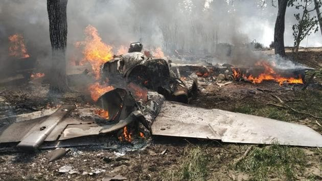 The pilot Rohit Katoch (36) ejected safely after steering his burning aircraft a few kilometres away from a rural residential area in Hatimpur locality.(HT PHOTO)