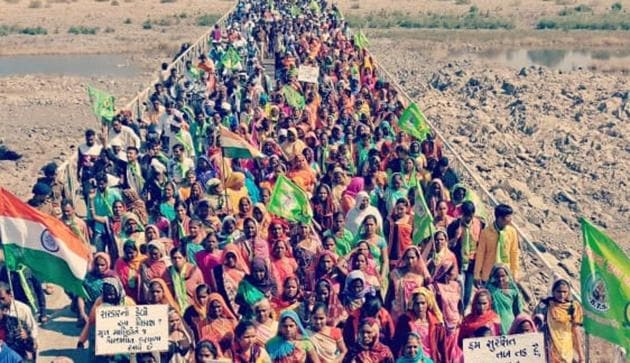 Thousands of tribals took out a 30-km long foot rally from Kevadiya to Rajpipla in Gujarat's Narmada district to protest against infrastructure development around the Statue of Unity.(HT Photo)