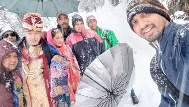 Groom along with his family treks to Makku Math in Rudraprayag district for his wedding ceremony after roads were blocked due to heavy snow.(HT Photo)