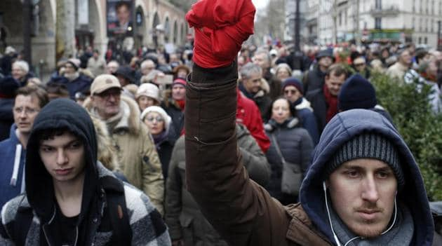 A man with his hand wrapped in a red scarf takes part in a rally in Paris, France, Sunday, Jan. 27, 2019. Hundreds of people wearing red scarves marched through Paris on Sunday.(AP Photo)