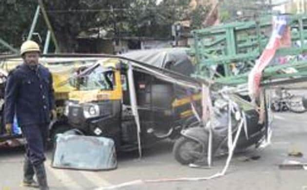 On October 5, four people were killed when a 40 feet tall metal hoarding fell on people waiting at a traffic signal near Juna Bazar.(HT/PHOTO)