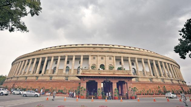 Dense clouds covers the capital's skyline overhead the Parliament House, in New Delhi.(HT Photo)