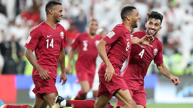 Qatar's Hamid Ismaeil celebrates scoring their fourth goal with team mates.(REUTERS)