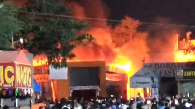 Hundreds of shops were gutted in a major fire at the All India Industrial Exhibition being held at the Exhibition Grounds at Nampally in Hyderabad on Wednesday night.(HT PHOTO)