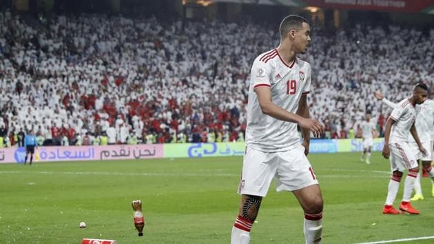 Bottles are thrown on the field by United Arab Emirates fans after Qatar's forward Hasan Al Haydos scores his side's third goal during the AFC Asian Cup semifinal soccer match between United Arab Emirates and Qatar.(AP)