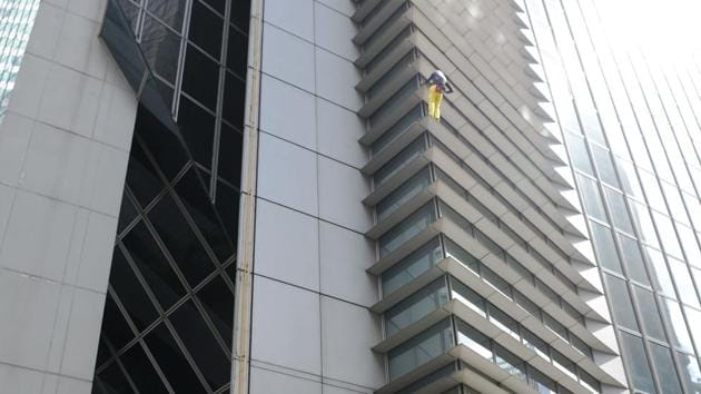 """Alain Robert, popularly known as the """"French Spiderman"""", climbing the 47-storey GT Tower in Manila.(AFP)"""