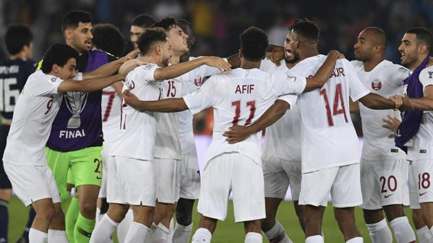 Players of Qatar run to celebrate after winning the AFC Asian Cup final match between Japan and Qatar in Zayed Sport City in Abu Dhabi, United Arab Emirates.(AP)