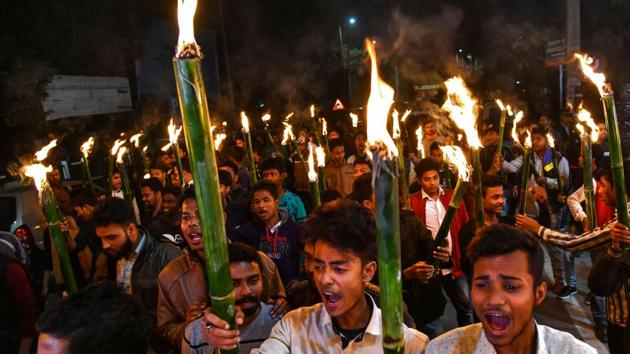 Activists of All Assam Students Union (AASU) along with 30 indigenous organizations take out a torch light procession to protest against the Citizenship Amendment bill in Guwahati on January 31.(AFP Photo)