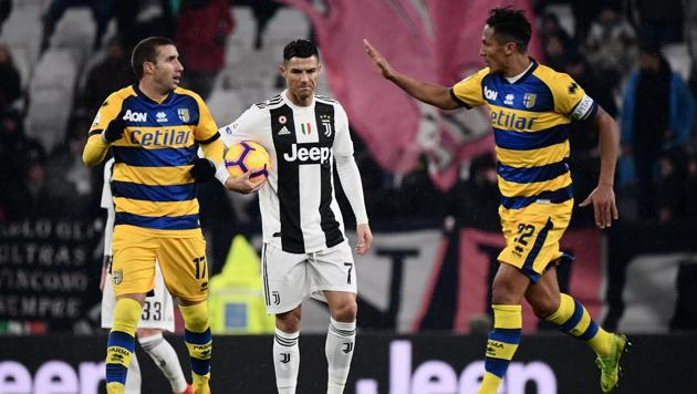Parma's Italian midfielder Antonino Barilla (L) celebrates with Parma's Portuguese defender Bruno Alves (R) after scoring, as Juventus' Portuguese forward Cristiano Ronaldo (C) reacts during the Italian Serie A football match Juventus vs Parma on February 2, 2019 at the Juventus stadium in Turin(AFP)