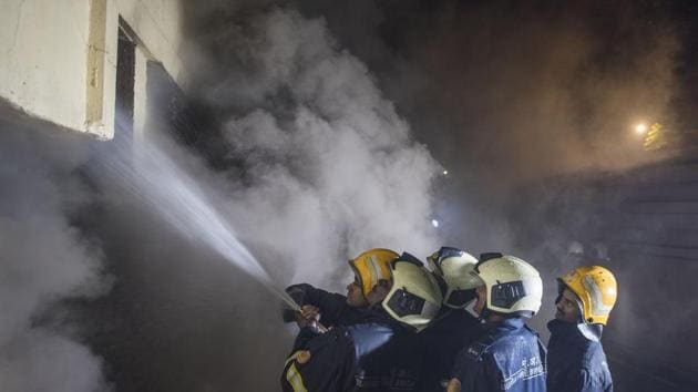 Fire fighers try to douse the fire that broke out in Sadhana house near BDD Chawl, Worli in Mumbai, on December 29, 2018.(HT FILE)