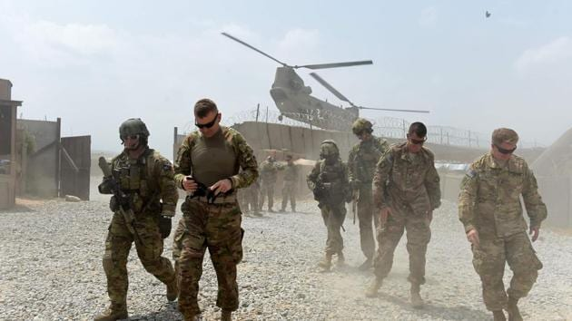 By promising a terrorist militia a total American military pullout within 18 months and a pathway to power in Kabul, the US, in essence, is negotiating the terms of its surrender.(AFP)