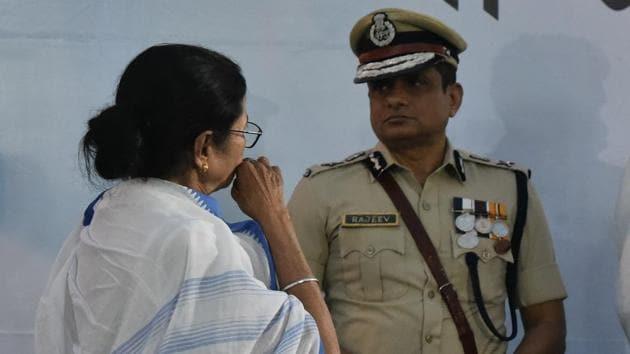 Kolkata police commissioner Rajeev Kumar with Mamata Banerjee during the police award ceremony at the dharna site in Esplanade, Kolkata, on Monday. (Photo by Arijit Sen/Hindustan Times)(Arijit Sen/HT Photo)
