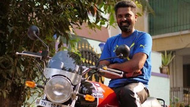 Director Prem Kumar poses with his new bike.
