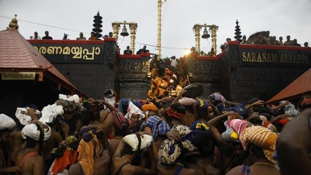 On September 28, the top court ruled by a 4-1 majority that no woman can be stopped from entering Sabarimala temple, ending a traditional ban on the entry of women into the over 800-year-old shrine in south Kerala's Pathanamthitta district.(HT Photo)