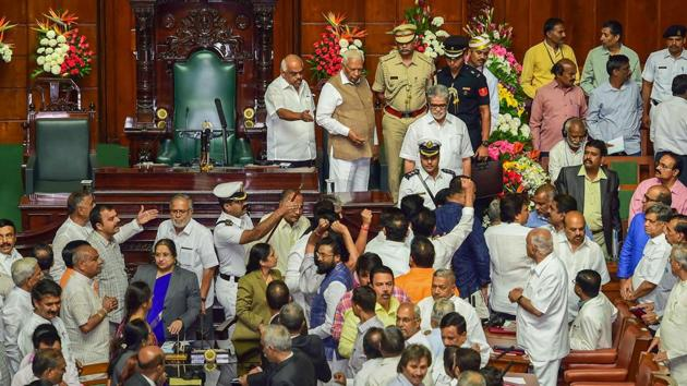 Bengaluru: BJP legislators protest as Karnataka Governor Vajubhai Vala leaves after addressing the joint session of Assembly on the first day of the Budget Session at Vidhan Soudha in Bengaluru, Wednesday, Feb 6, 2019. (PTI Photo/Shailendra Bhojak) (PTI2_6_2019_000109B)(PTI)
