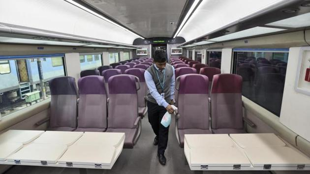 New Delhi, India - Jan. 2, 2019: A worker cleans the interior of T-18 train which has diffused lighting, automatic doors and footsteps beside GPS-based passenger information system on January 2.(Burhaan Kinu/HT PHOTO)