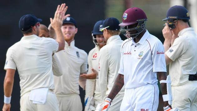 Alzarri Joseph (2R) of West Indies walks off the field as England players celebrate his dismissal during day 4 of the 3rd and final Test between West Indies and England.(AFP)