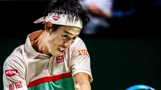 Japan's Kei Nishikori plays a backhand return to France's Pierre-Hugues Herbert during their men's singles match on day two of the ABN AMRO World Tennis Tournament in Rotterdam.(AFP)