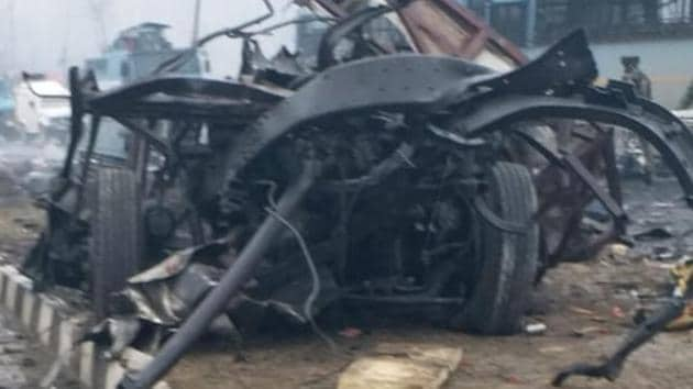 The mangled remains of the security forces vehicle that was blown up in a suicide attack at Lethpora in Pulwama, Kashmir.(HT Photo)