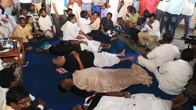 Puducherry chief minister V Narayanasamy and his cabinet colleagues sleep outside governor Kiran Bedi's house in protest.