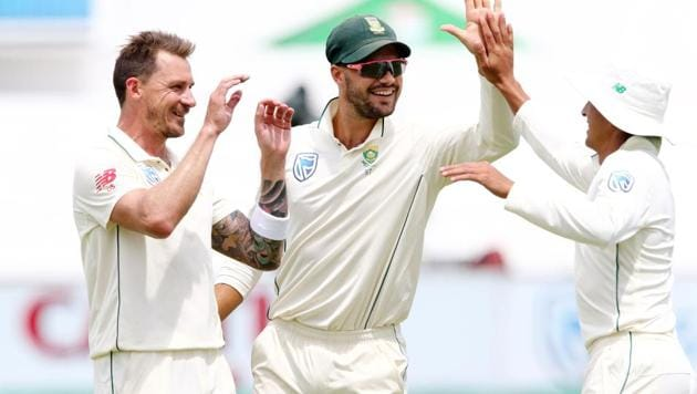 South Africa's Dale Steyn (L), Aiden Markram and Zubayr Hamza (R) celebrate the wicket of Sri Lanka's Kusal Perera during day 2 of the first test match between South Africa and Sri Lanka held at the Kingsmead Stadium in Durban on February 14, 2019(AFP)