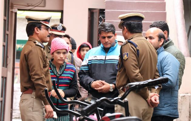 CRPF officials with the family members of CRPF jawan Mohan Lal Raturi at his residence in Dehradun on Friday, Feb 15, 2019.(HT Photo)