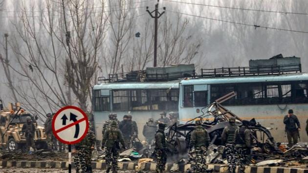 Security personnel carry out the rescue and relief works at the site of suicide bomb attack at Lathepora Awantipora in Pulwama district of south Kashmir, February 14(PTI)