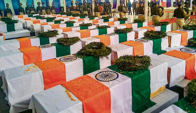 Tricolor draped coffins of the CRPF personnel, who lost their lives in Thursday's Pulwama terror attack, during wreath laying ceremony at the CRPF camp in Budgam.(PTI)